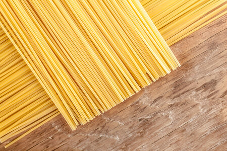 posted: pasta posted on the a row on a wooden background