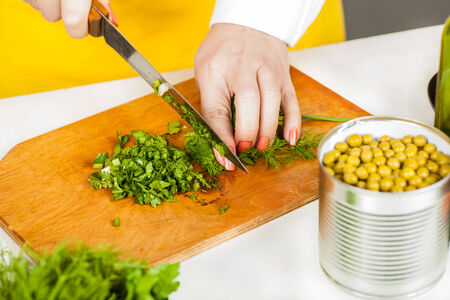 shred: Chef woman finely shred dill and parsley closeup