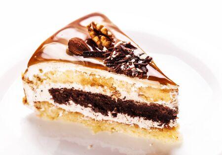 nutty: fresh nutty piece of cake on a white background