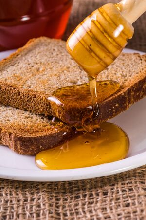 drenched: toast drenched with honey close-up on a vintage background