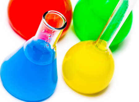 reagents: jar with colored reagents closeup  on a white background