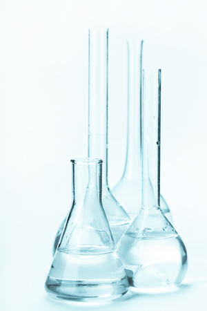 reagents: variety of glass flasks with reagents on a light background