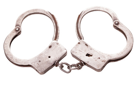 metal handcuffs: made of metal handcuffs isolated on a white background Stock Photo