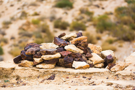 canyon negev: pile of stacked stones in the desert