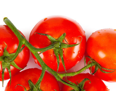 ensalada tomate: bunch of ripe tomatoes closeup isolated on white background