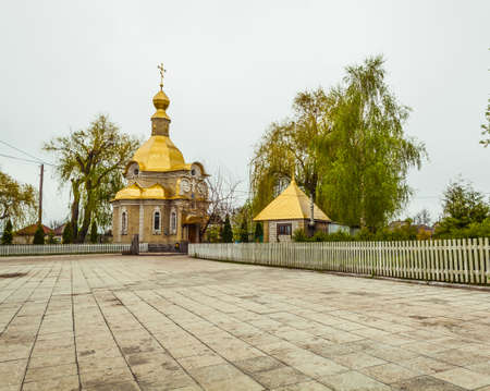 house of god: church with gold domes on background of sky