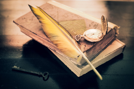 cover background time: two old books, watches, key and feather