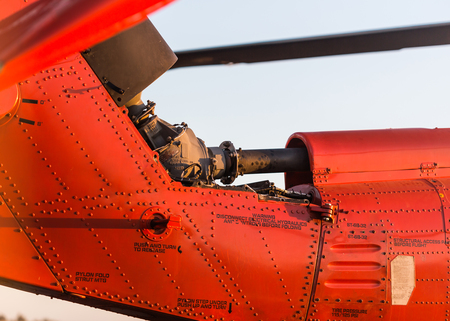 military helicopter: Orange military helicopter at the airport closeup