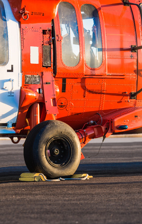 embark: Orange military helicopter at the airport closeup