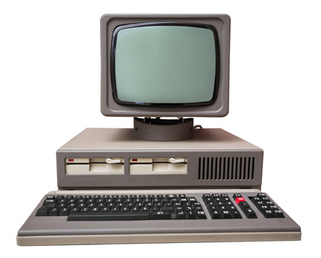 technology to communicate: Old gray computer isolated on a white background Stock Photo