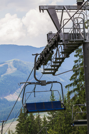 chair on the lift: chair lift on a background the Carpathian Mountains