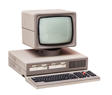 old technology: Old gray computer isolated on a white background Stock Photo