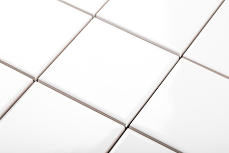 the background of white ceramic tiles closeup