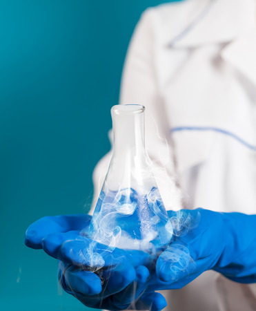 laboratorian: chemical reagent a test tube in the hand Stock Photo