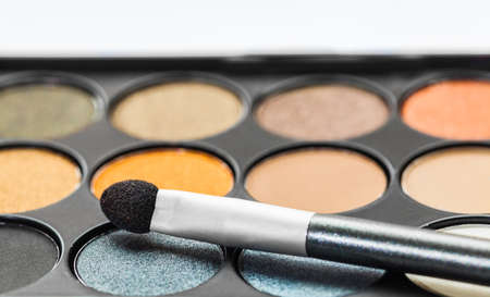eyemakeup: set of decorative cosmetics, Eyeshadow Palette and brush Stock Photo