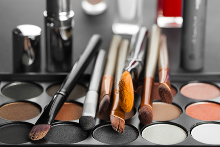 eyemakeup: set of decorative cosmetics on a dark background