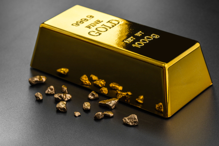 goldmine: gold bullion and nuggets on a dark background
