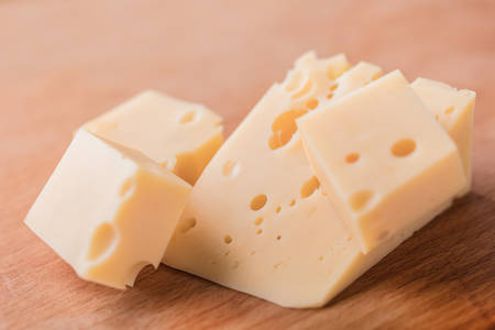 cheez: fresh piece of cheese on a wooden background