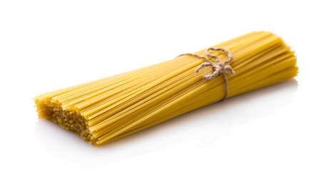 uncooked: uncooked spaghetti closeup isolated on white background Stock Photo