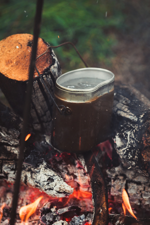 meal preparation: meal preparation in a pot on the fire