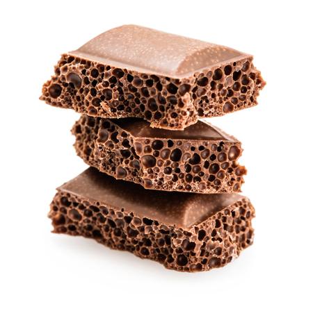 porous: part porous chocolate isolated on white background