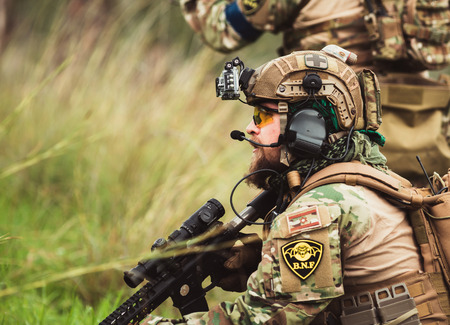 soldiers: soldiers on maneuvers Editorial