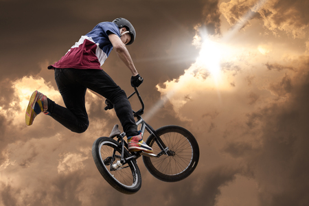 extreme sport bmx, jump against the sky