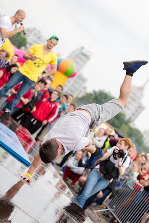 calisthenics: Kharkiv, Ukraine - June 11, 2016: Man performs a trick Battle Barstylers Workout on Freedom Square in Kharkov Editorial