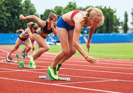 Women starting the race in the stadium photo