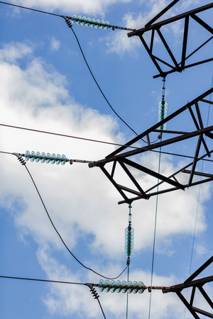 high voltage electric pole on the background of sky