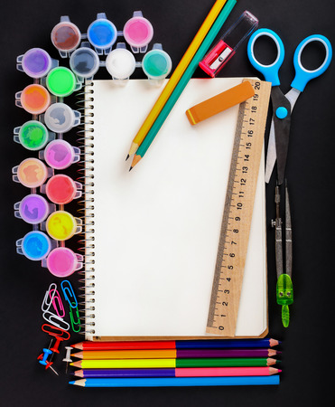 set of school stationery on a black background Stock Photo