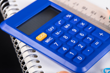 calculator and Office supplies close-up on a black background