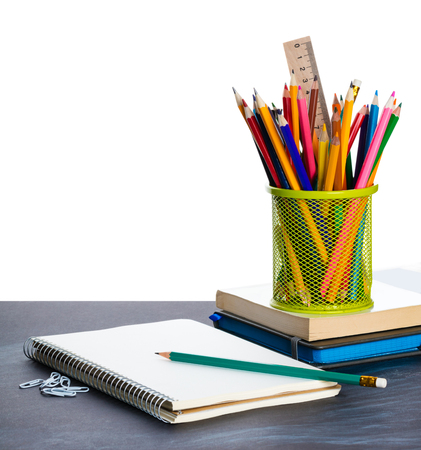 notebook and a container of pencils on the table