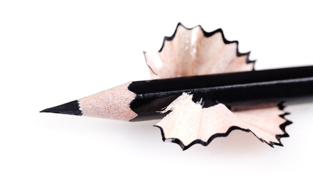 sharpened: black sharpened pencil close-up on a white background
