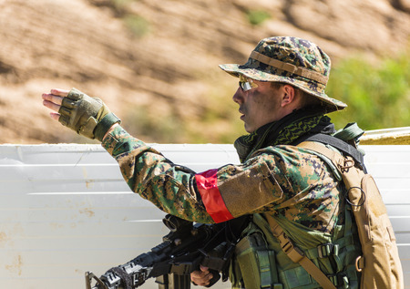 soldier in uniform with weapon on a mission