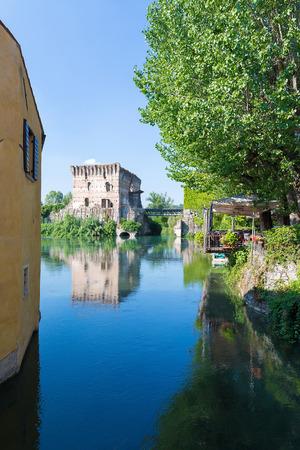 medieval building upon the Mincio river in Borghetto, Verona, Italy Stock Photo