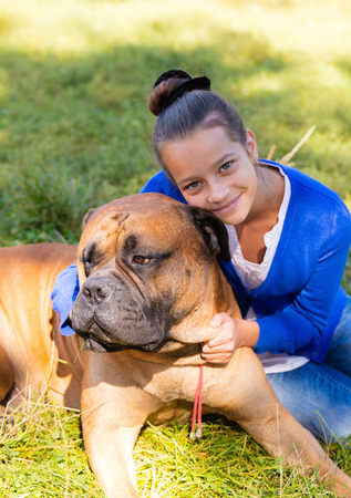 bullmastiff: teen girl with the dog Bullmastiff outdoors