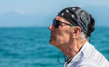 Portrait of an elderly man against the sea Stock Photo