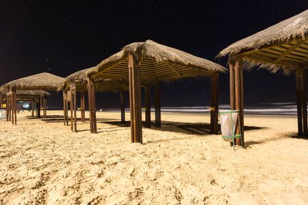 canopies: canopies from sun on the beach at night