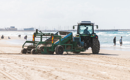 ashdod: ASHDOD, ISRAEL - January 13, 2017: tractor cleans the sand on the beach