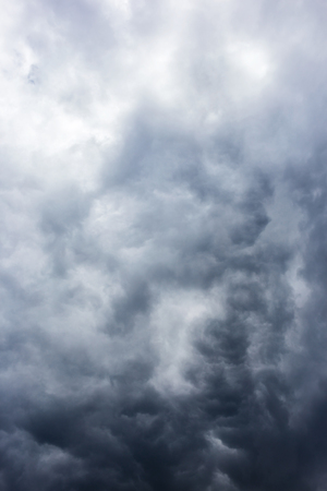 Abstract background, dark sky with clouds close-up