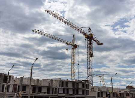 Industrial landscape, construction of high-rise buildings and cranes Stock Photo