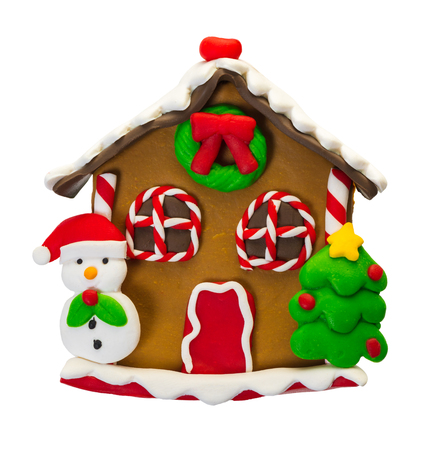 Christmas gingerbread house on white isolated background