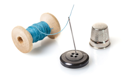 Thread with needle on white isolated background
