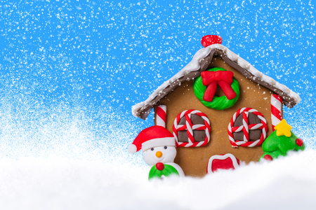 ginger house in the snow, festive background Stock Photo