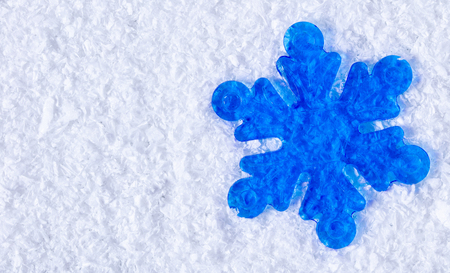 festive background, decorative snowflake decoration on the snow