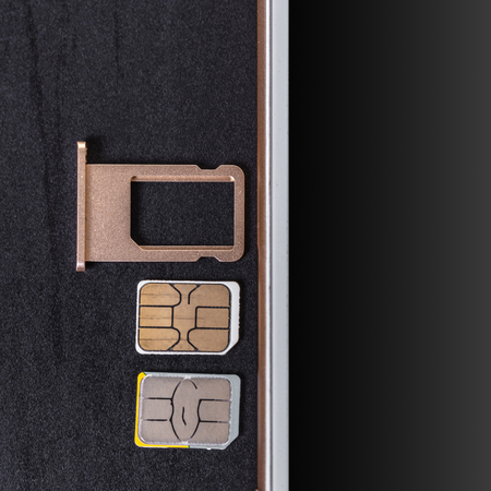 mobile phone and sim card on a black background