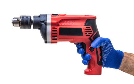 new electric drill in male hand on white isolated background