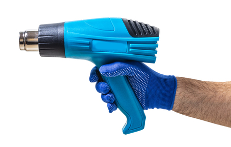 construction tool, hairdryer in male hand on white isolated background