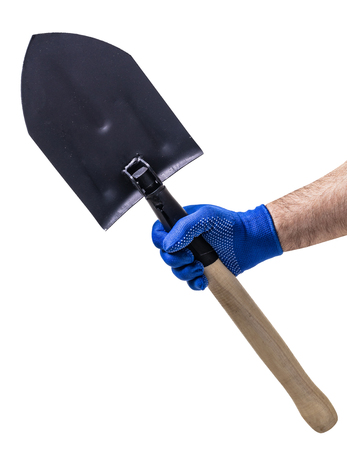 new shovel in male hand on white isolated background